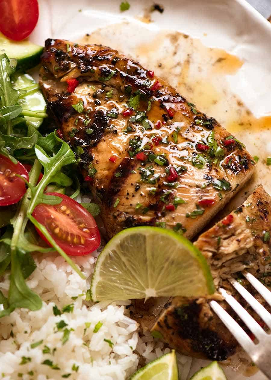 Cilantro Lime Chicken on a plate with a side of coconut lime rice and a garden salad