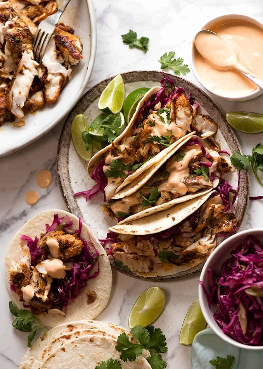 Fish Tacos with sides and toppings - pickled cabbage and fish taco sauce