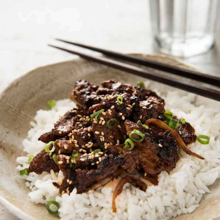 Spicy Korean Pork Stir Fry with chopsticks