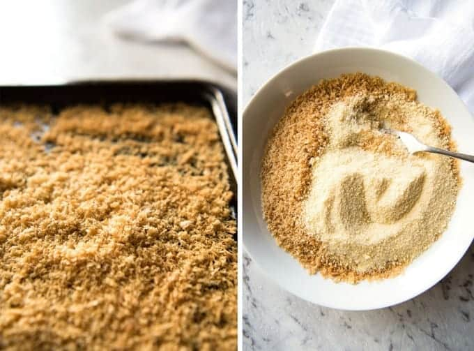 A tray with golden toasted panko breadcrumbs and a bowl with parmesan mixed with breadcrumbs.