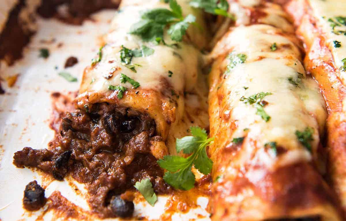 The BEST Beef Enchiladas, with an extra tasty, extra saucy filling and the most incredible homemade Enchilada Sauce! www.recipetineats.com