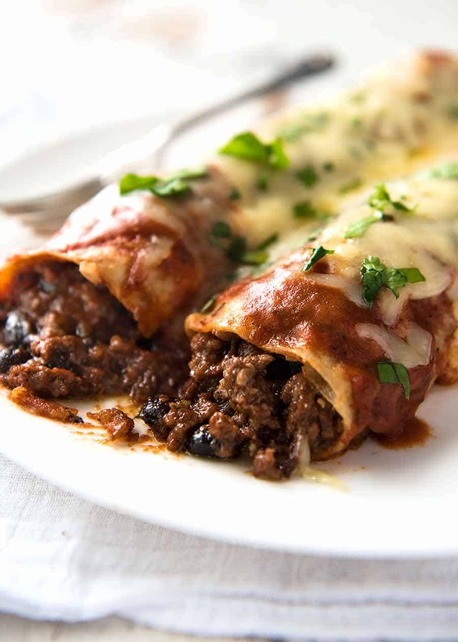 Close up of Beef and Bean Enchiladas on a plate, ready to be eaten