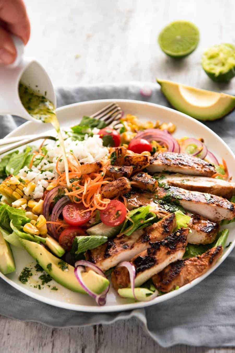 A salad with chicken marinated in pineapple juice, coconut milk & spices and a beautiful cilantro (coriander) lime dressing. The flavours of Hawaii - in a salad! recipetineats.com