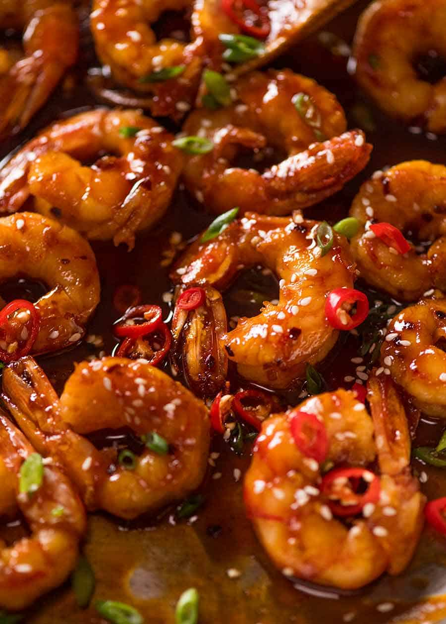 Close up of sticky Asian spicy garlic shrimp