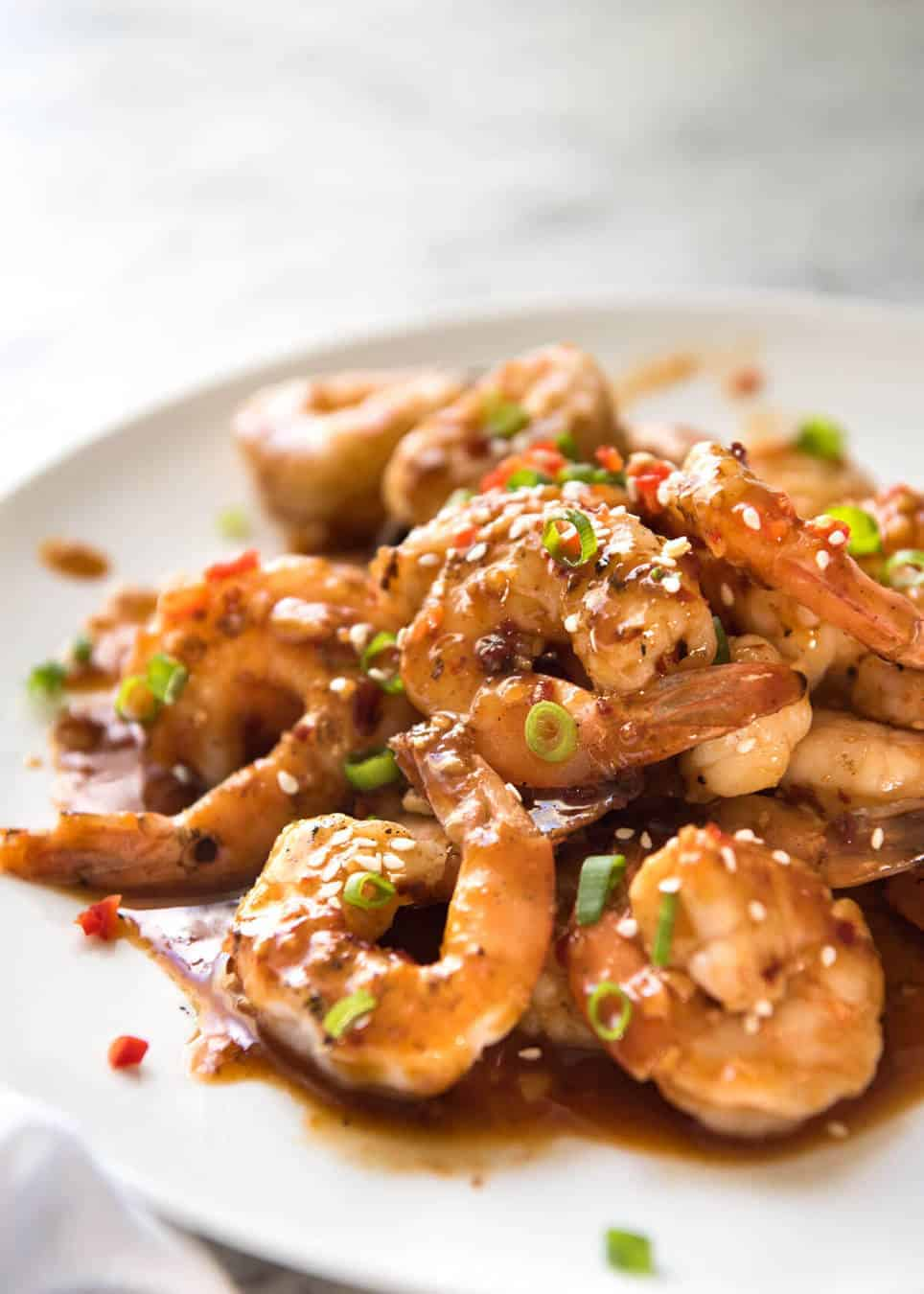 Asian Chilli Garlic Prawns - Juicy prawns in a sweet, sticky, spicy, garlicky sauce. Dinner on the table in 10 minutes! www.recipetineats.com