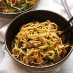 Chicken Chow Mein in a black bowl, ready to be eaten