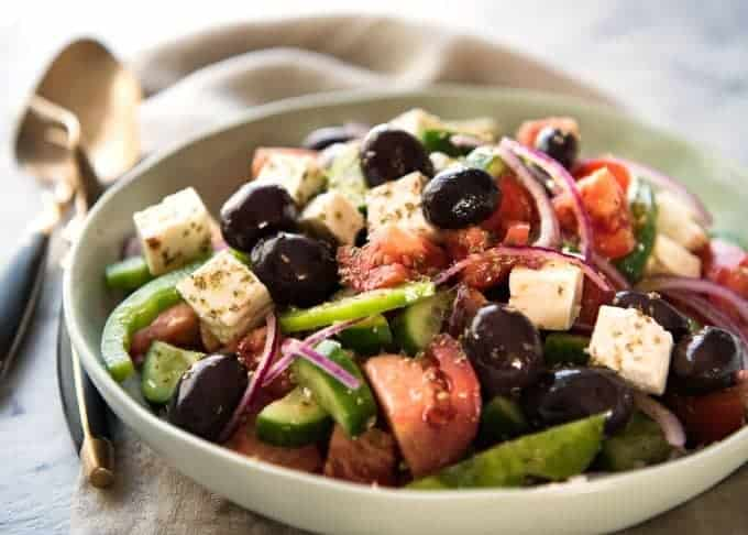 A classic Greek Salad with plump olives and a beautiful homemade Greek Salad Dressing. recipetineats.com