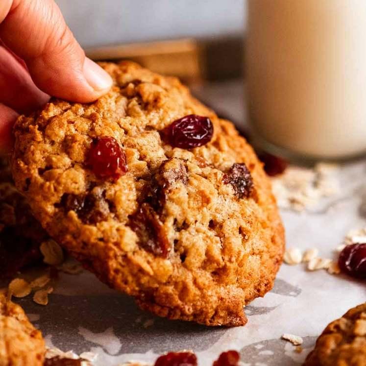 Hand picking up Oatmeal Raisin Cookies