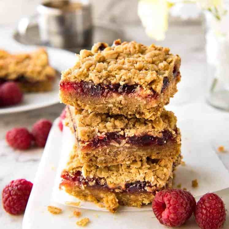 Raspberry Bars - One of the fastest bars to make from scratch, these have an oatmeal biscuit base, raspberry jam and a crumbly oatmeal topping. Just 10 minutes prep! recipetineats.com