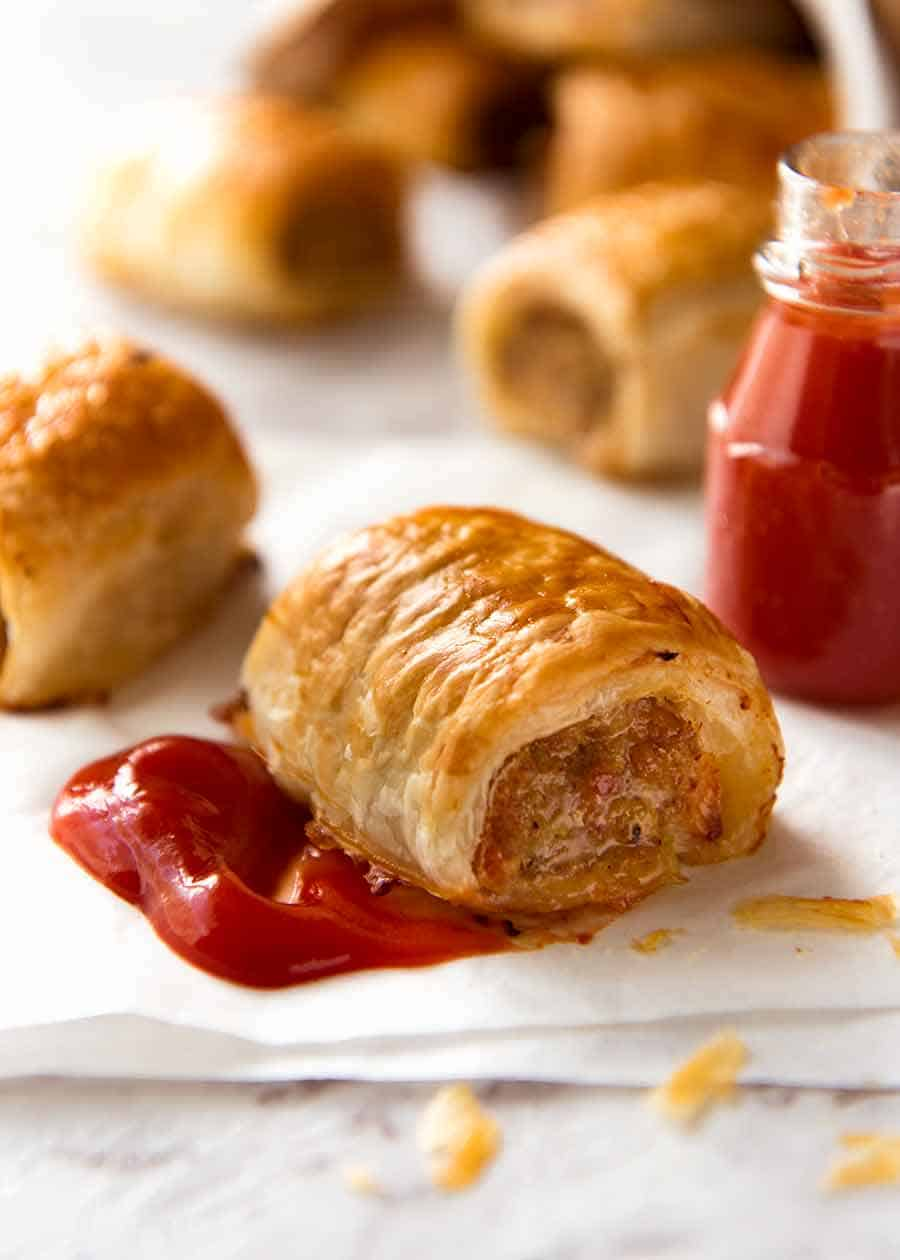 Close up of Sausage Roll with tomato sauce