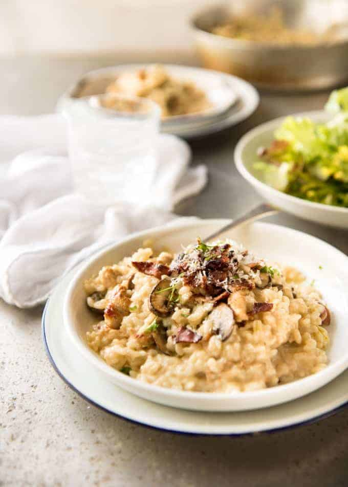 Chicken and Mushroom Risotto - Creamy risotto with golden brown sautéed mushrooms and chicken. Easy, perfectly seasoned and beautifully creamy! recipetineats.com