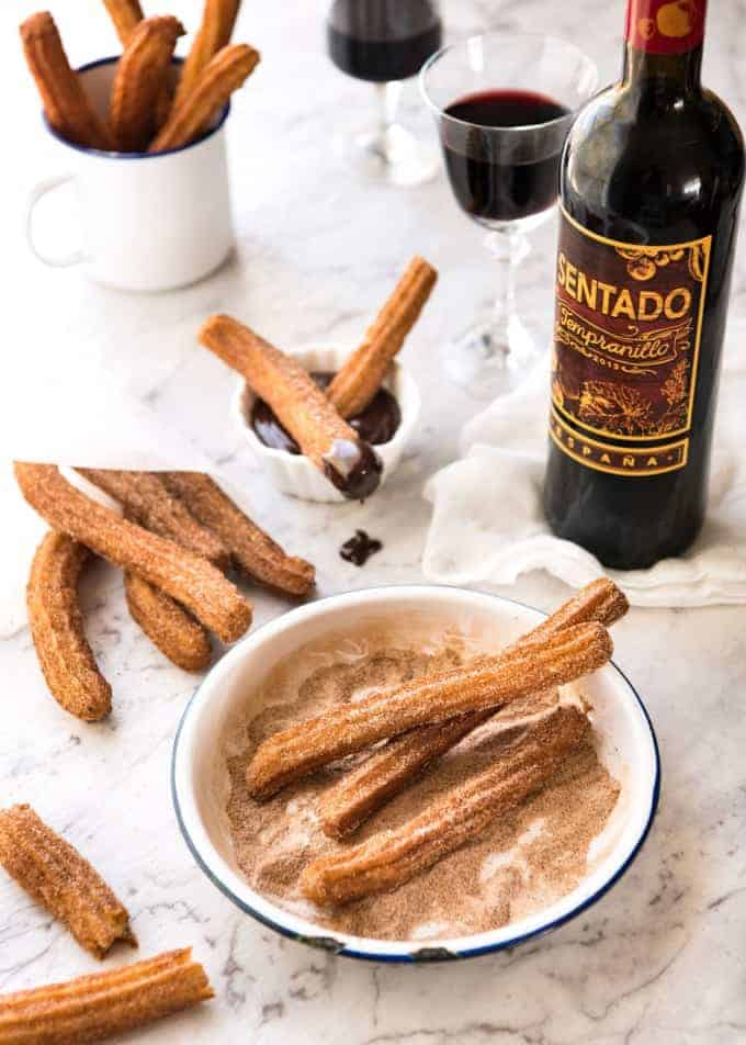 Spanish Churros Recipe - Surprisingly easy to make, the batter is made with just flour, baking powder, olive oil and water. 20 minutes, start to finish! www.recipetineats.com