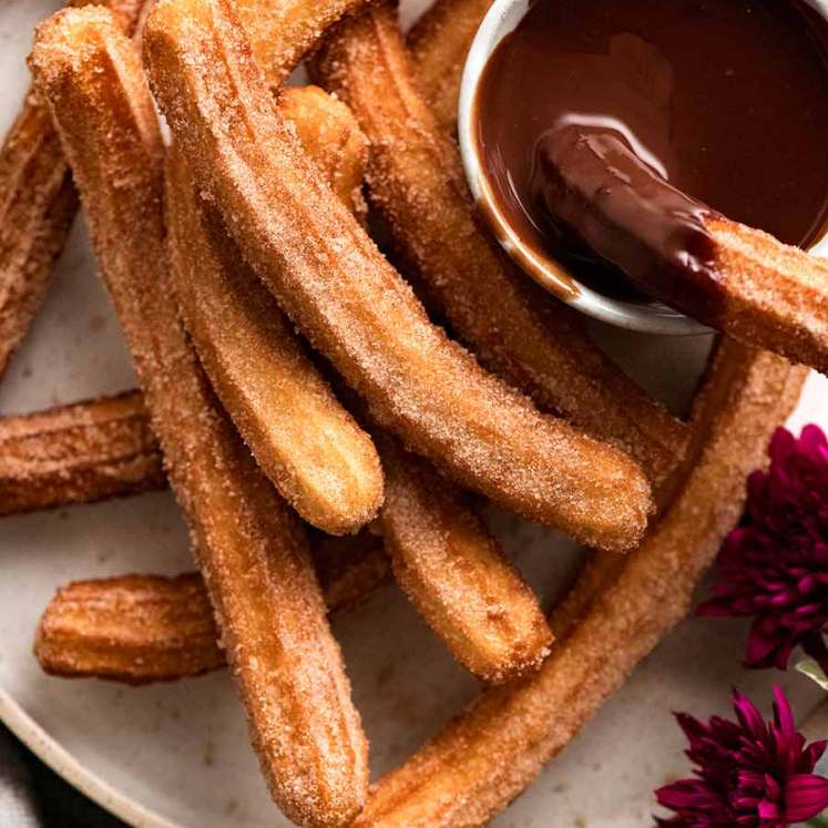 Plate of Churros recipe with chocolate dipping sauce