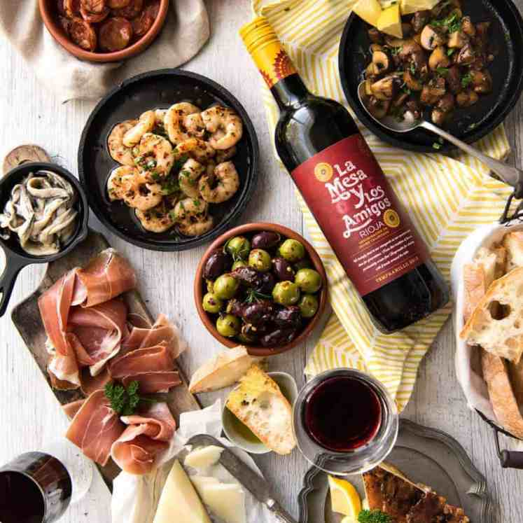5 Easy Spanish Tapas recipes - all your favorites from the tapas bar! Garlic mushrooms, chorizo, garlic shrimp/prawns, Spanish marinated olives , Spanish omelette and a cheese platter! recipetineats.com