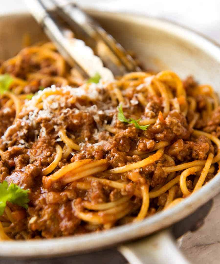 Bolognese Sauce and pasta tossed in a pan, ready to be served.