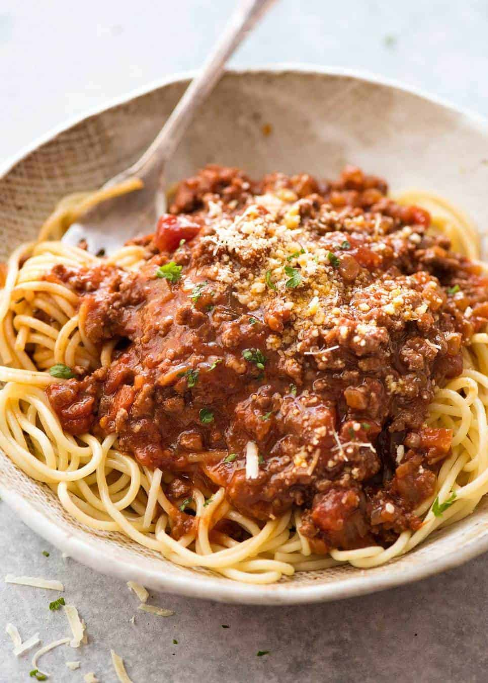 Spaghetti Bolognese in a rustic bowl, ready to be served.