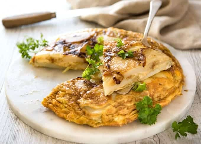 Spanish Tortilla (Omelette) - One of the best omelettes in the world, made with just eggs, potatoes, onion and olive oil! www.recipetineats.com