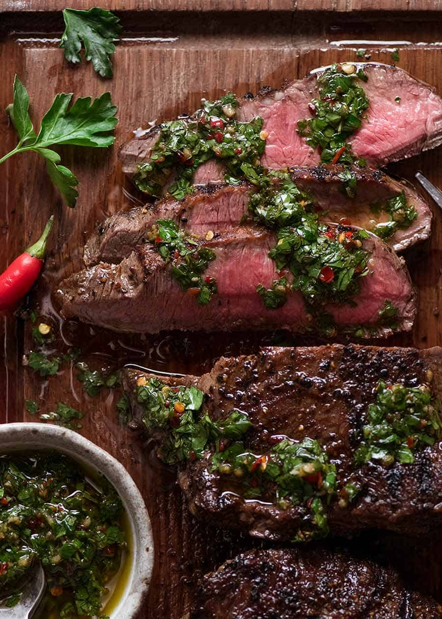 Overhead photo of Chimichurri Steak on a cutting board, ready to be served