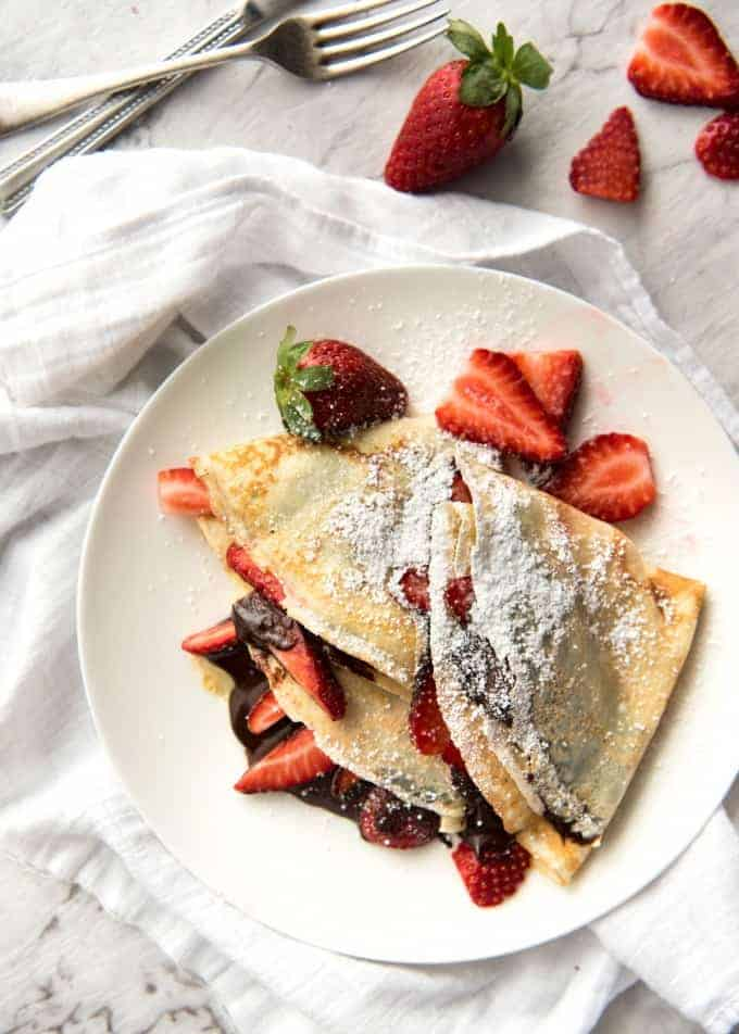 Nutella Crepes with Strawberries - The batter is a 10 second job when made with a blender! And you do not need a crepe pan, just a skillet! www.recipetineats.com