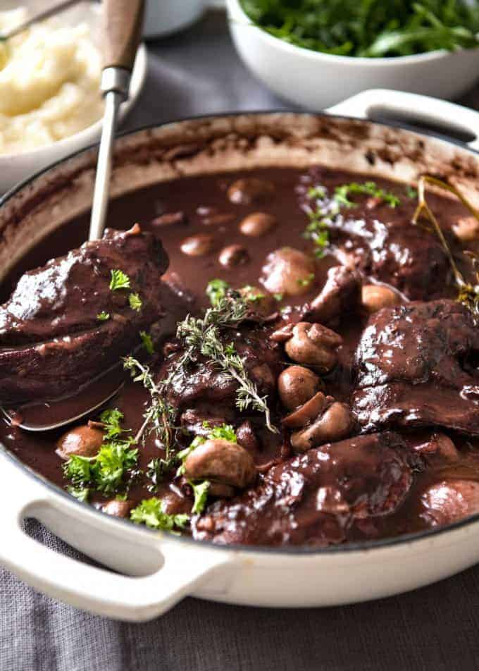 A traditional Coq au Vin recipe, with very tender chicken in a rich red wine sauce. Incredibly easy to make! recipetineats.com