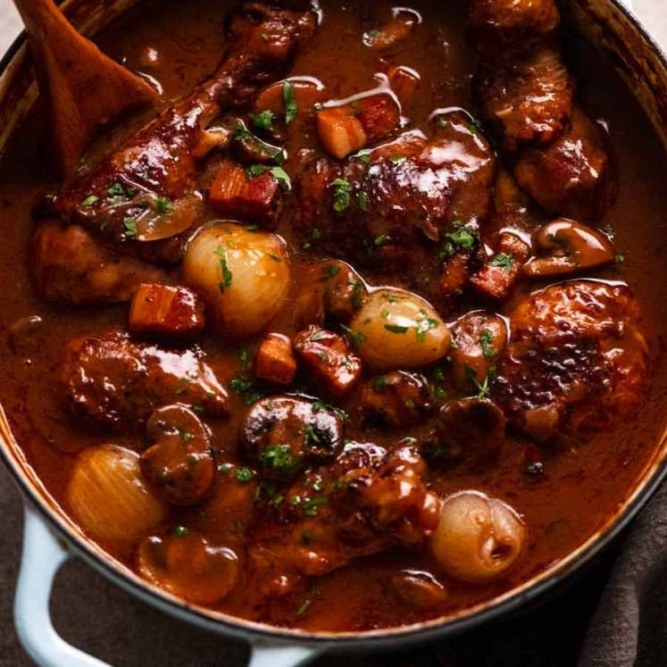 Coq au Vin in a pot, ready to be served