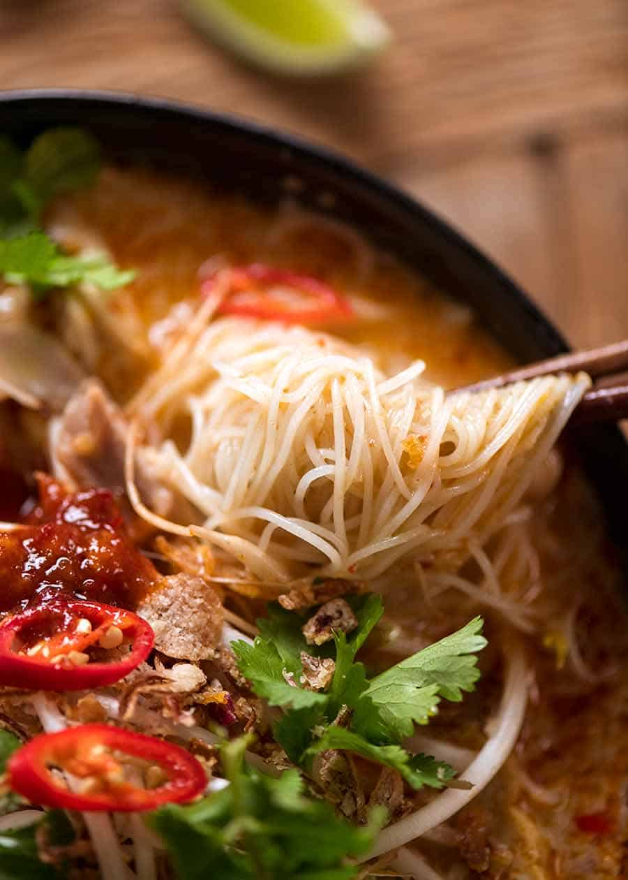 Vermicelli Noodles in Laksa Soup broth in a pot, fresh off the stove