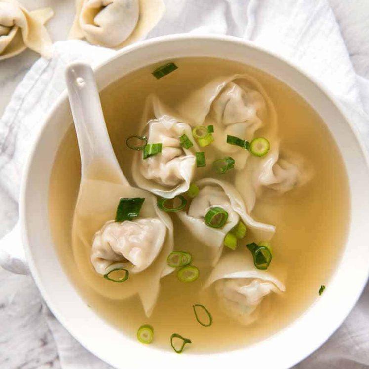Wonton Soup in a white bowl, ready to be eaten