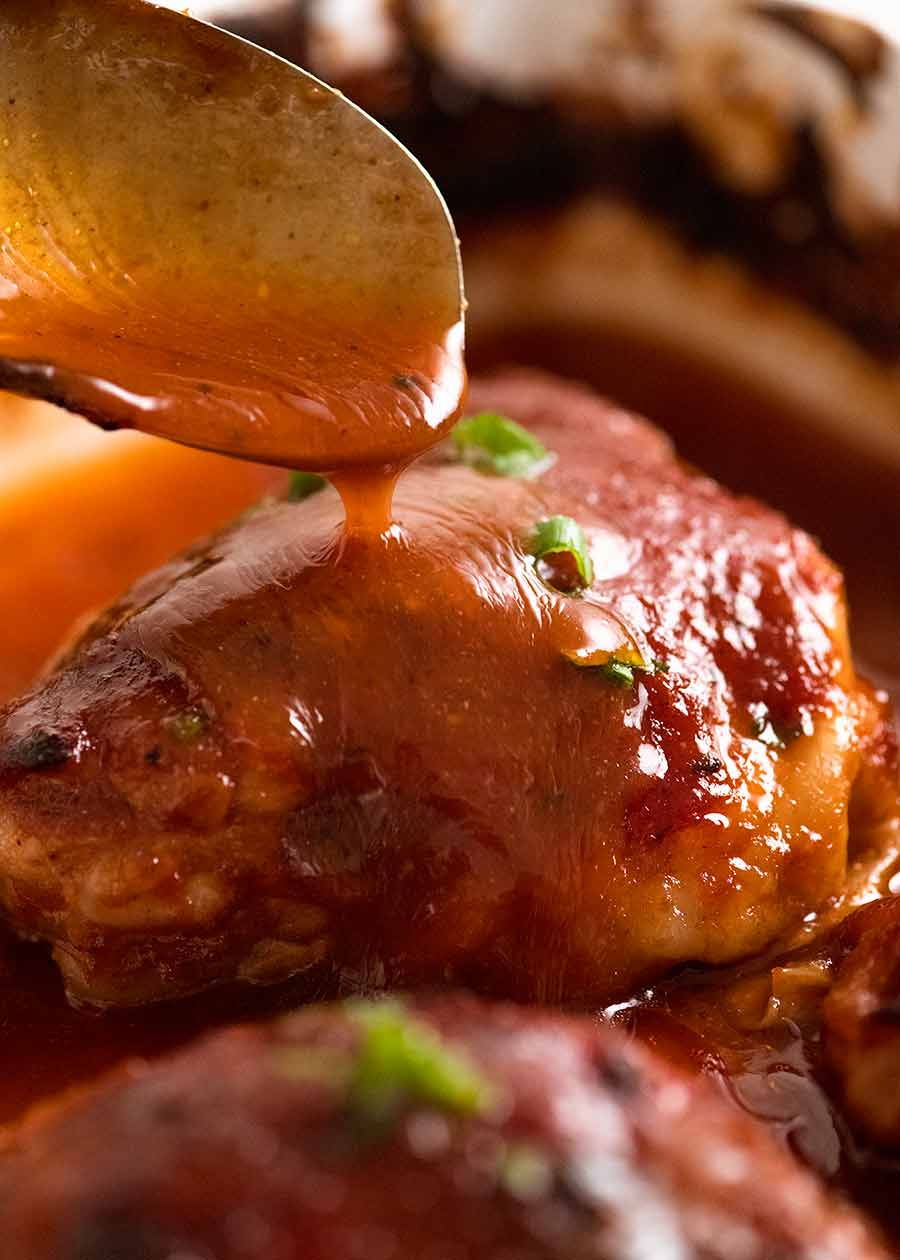 Pour barbecue sauce over Oven Baked BBQ Chicken