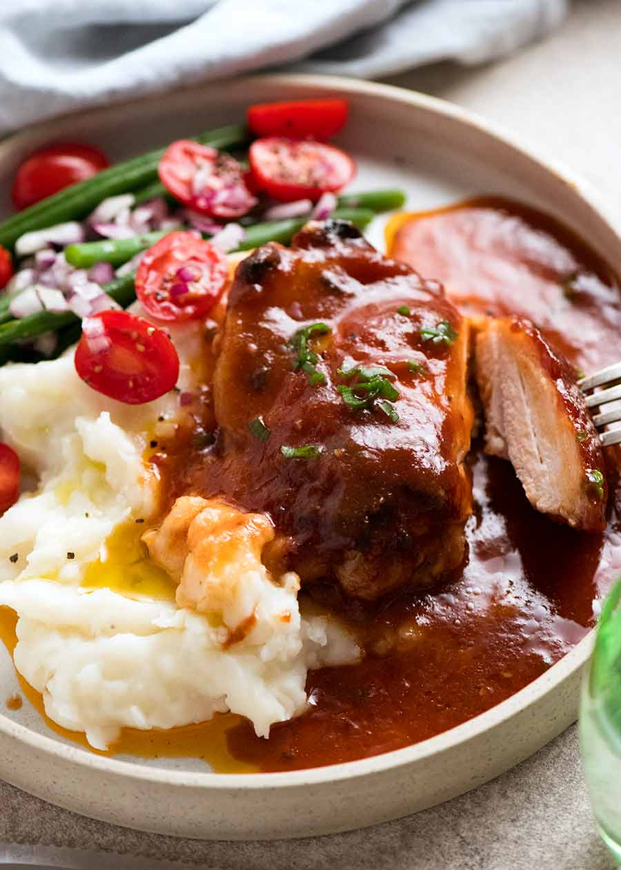 Oven Baked Barbecue Chicken with homemade Barbecue Sauce dinner plate - mashed potato and green bean salad on the side