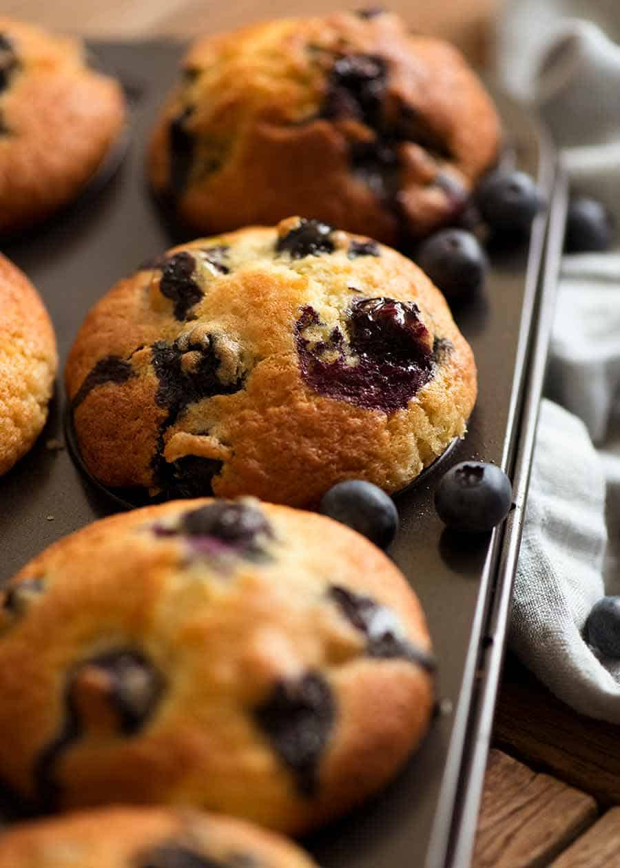 Blueberry Muffins in a muffin tin, fresh out of the oven