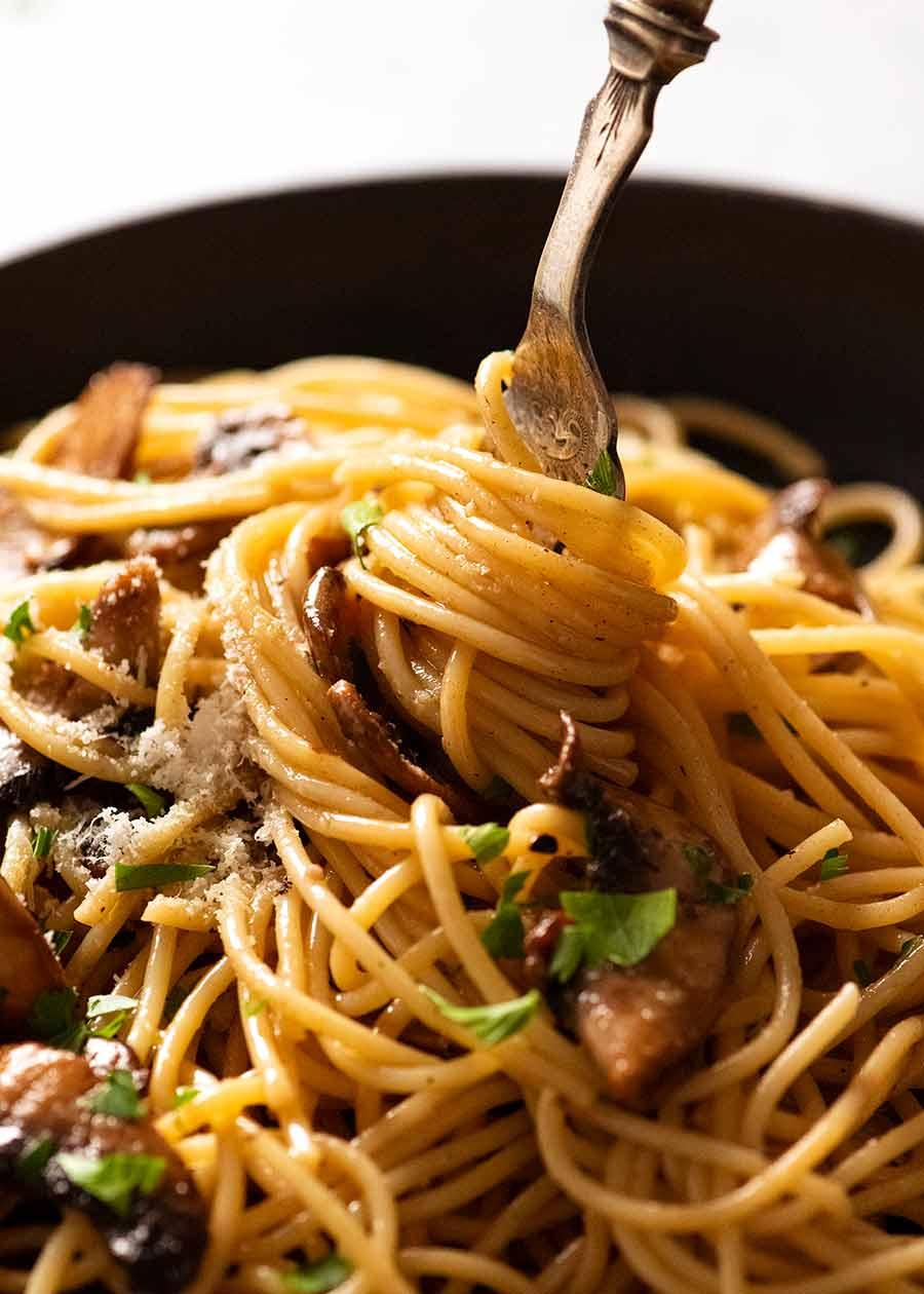 Fork twirling mushroom pasta