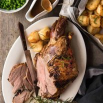 A classic, perfectly cooked Roast Lamb Leg with a classic smooth, rich gravy. It's Lambalicious! www.recipetineats.com