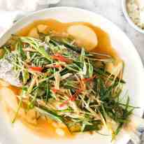 A Chinese Steamed Fish topped with Ginger and Shallots and seasonings, with hot oil poured over it to create a dramatic sizzle and an amazing sauce. So simple, yet so utterly delicious. Steam OR bake the fish! recipetineats.com