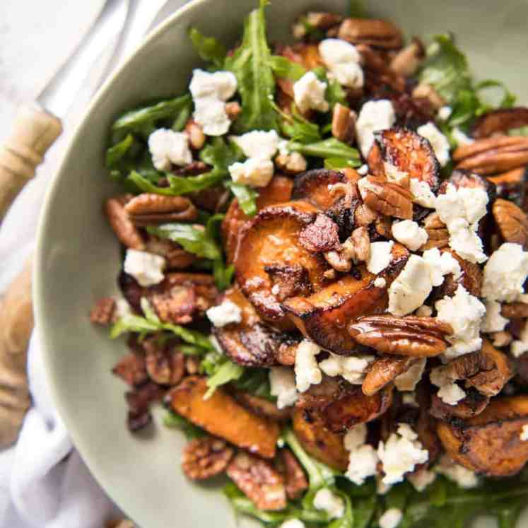 Roasted Sweet Potato Salad - with arugula/rocket, pecans, goats cheese or feta, a sprinkle of bacon and a beautiful Honey Lemon dressing. recipetineats.com