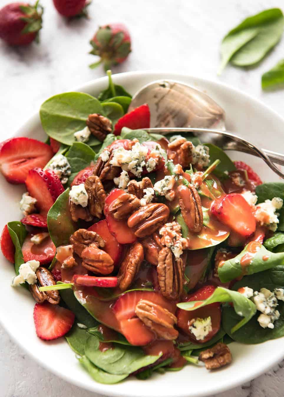 A stunning Chef recipe for a Strawberry Spinach Salad. Spinach, fresh strawberries, blue cheese and candied pecans with a Strawberry Balsamic Dressing. recipetineats.com