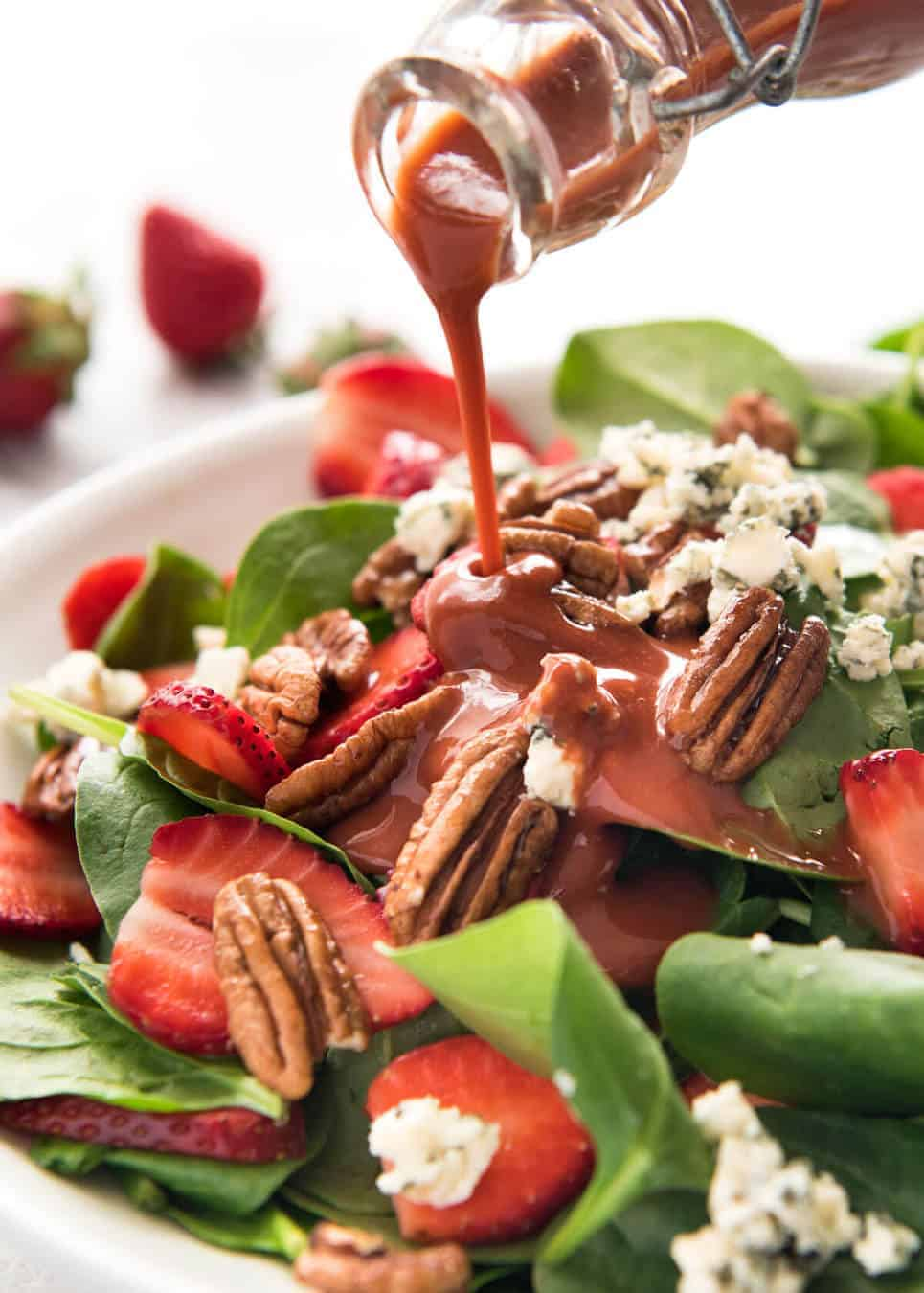 A stunning Chef recipe for a Strawberry Spinach Salad. Spinach, fresh strawberries, blue cheese and candied pecans with a Strawberry Balsamic Dressing. www.recipetineats.com