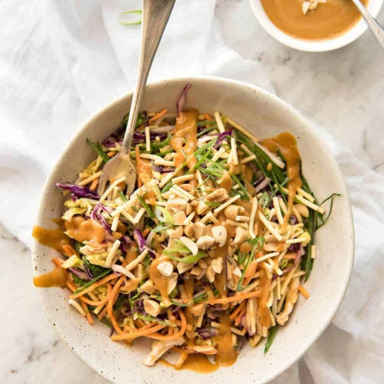 Chinese Chicken Salad with Peanut Dressing - made with cabbage, shredded chicken, crunchy noodles, carrot and a killer peanut dressing! www.recipetineats.com