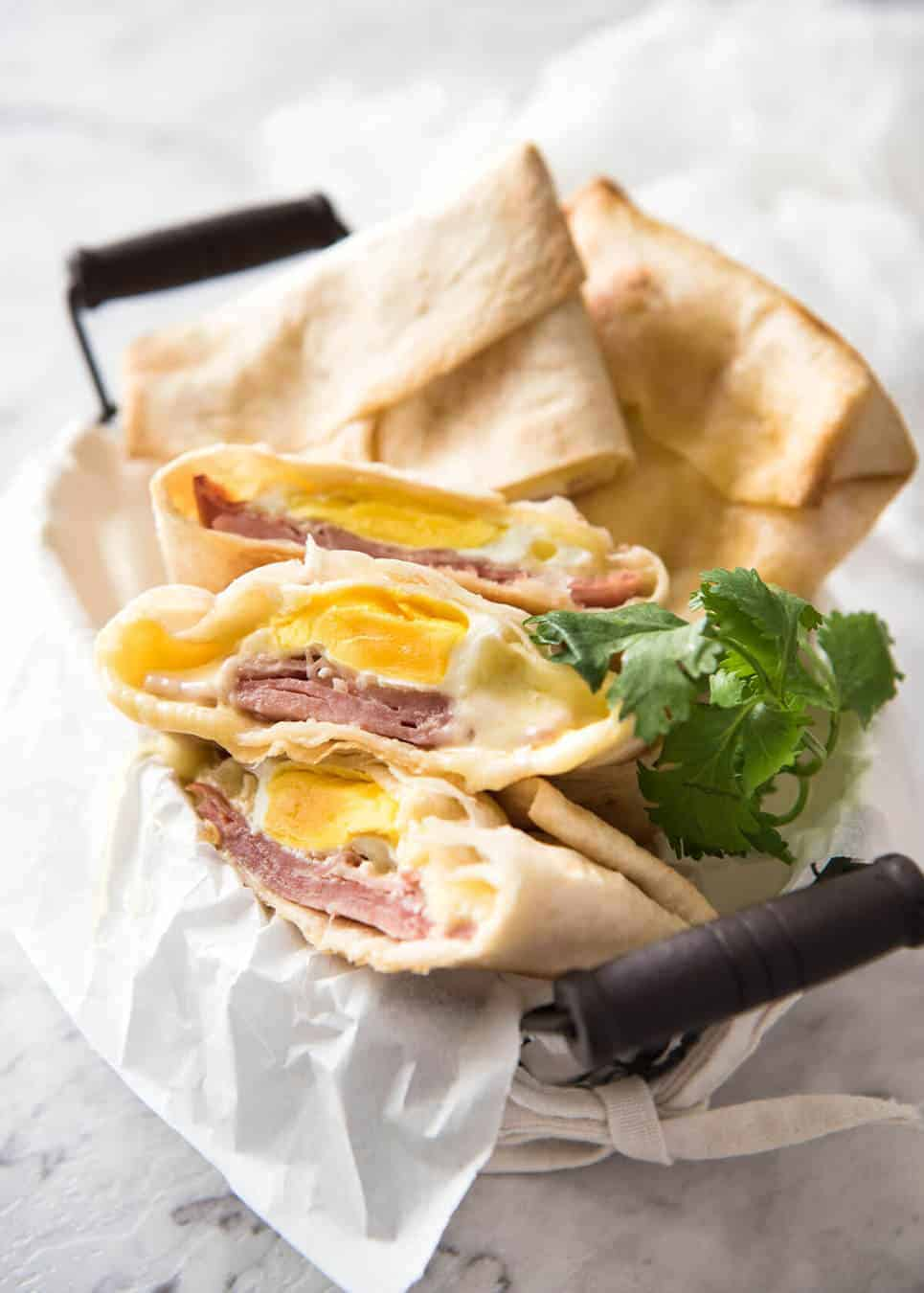 Hot Ham Egg And Cheese Pockets Made With Tortillas In A Basket Some