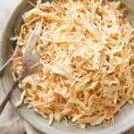 Classic Coleslaw with a dressing made with mayonnaise, sour cream, mustard, sugar and celery salt. www.recipetineats.com