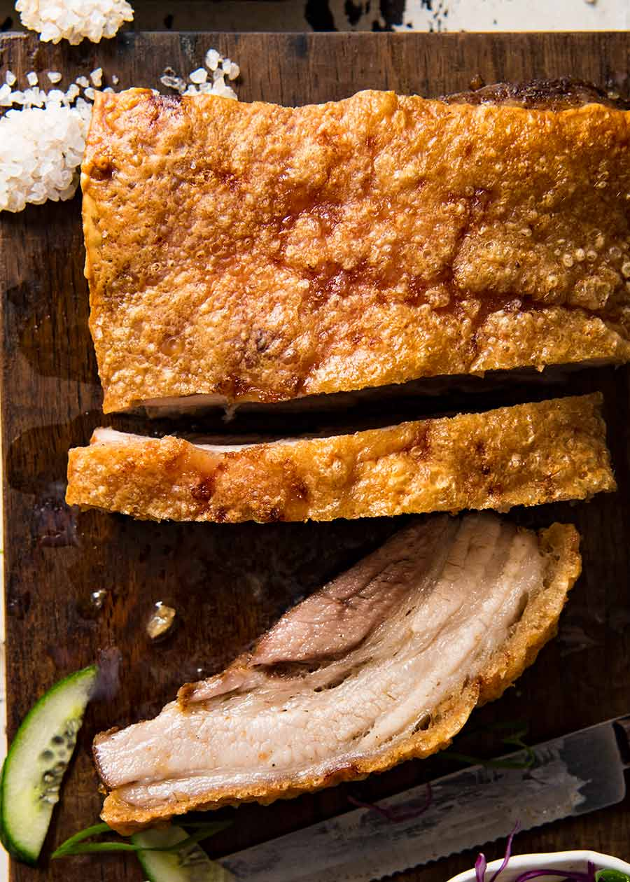 Overhead photo of Chinese Crispy Pork Belly with some slices cut
