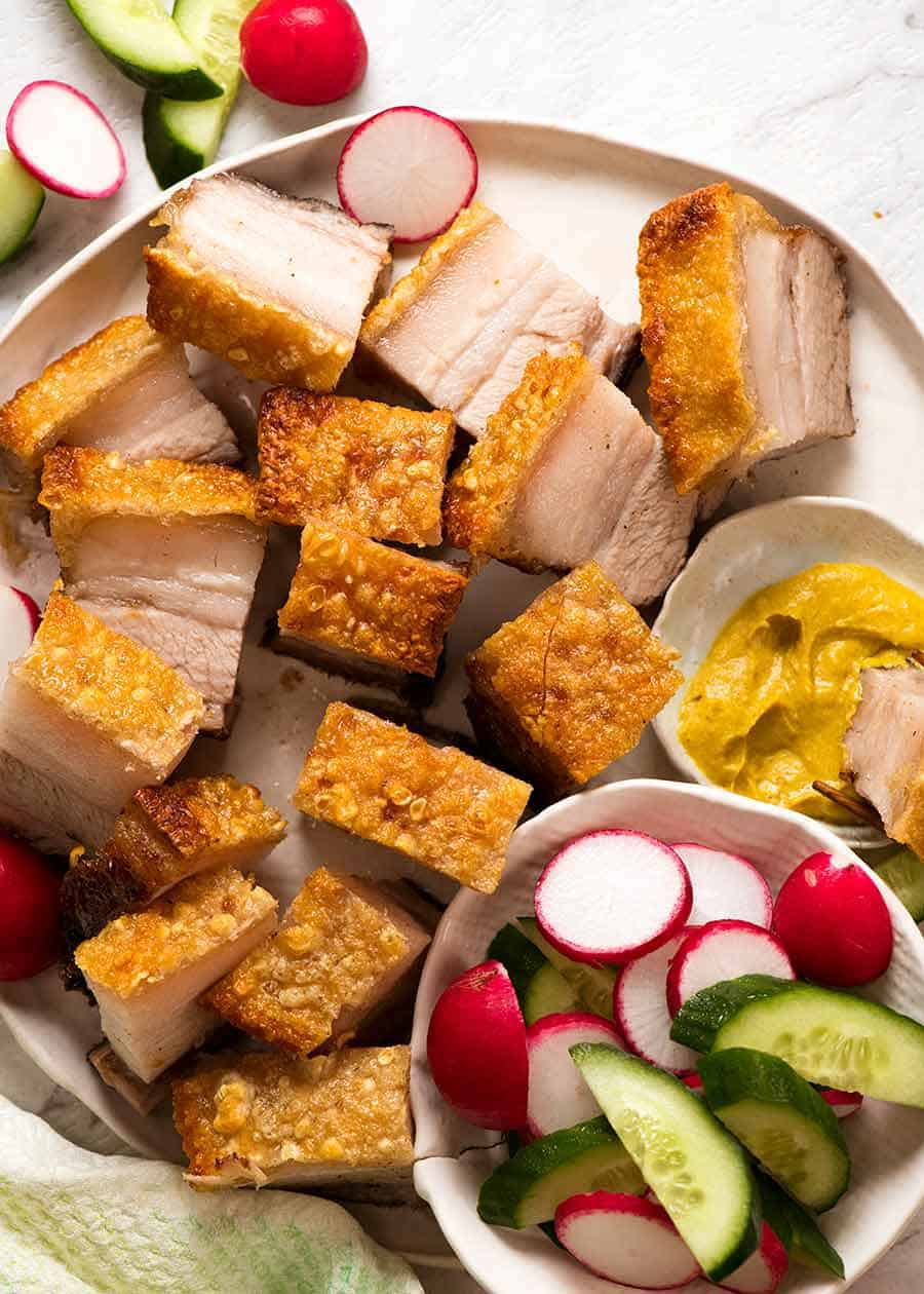 Plate of Chinese Crispy Pork Belly with the best crackling in the world. Pork belly slices on a plate, ready to be served