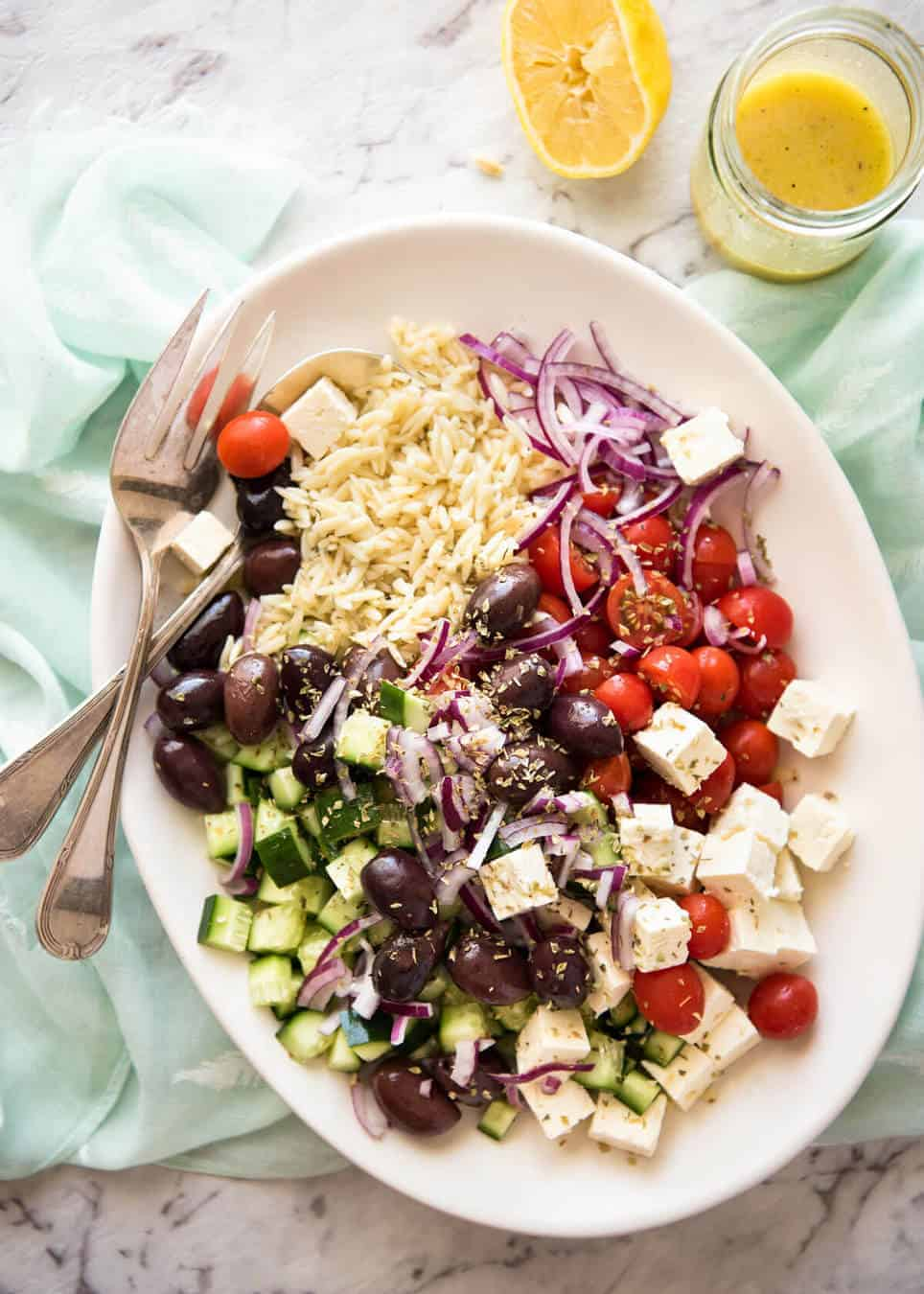 Greek Lemon Orzo Salad (Risoni) - All the fixings of a Greek Salad tossed through orzo / risoni and dressed with a gorgeous zesty lemon vinaigrette. www.recipetineats.com