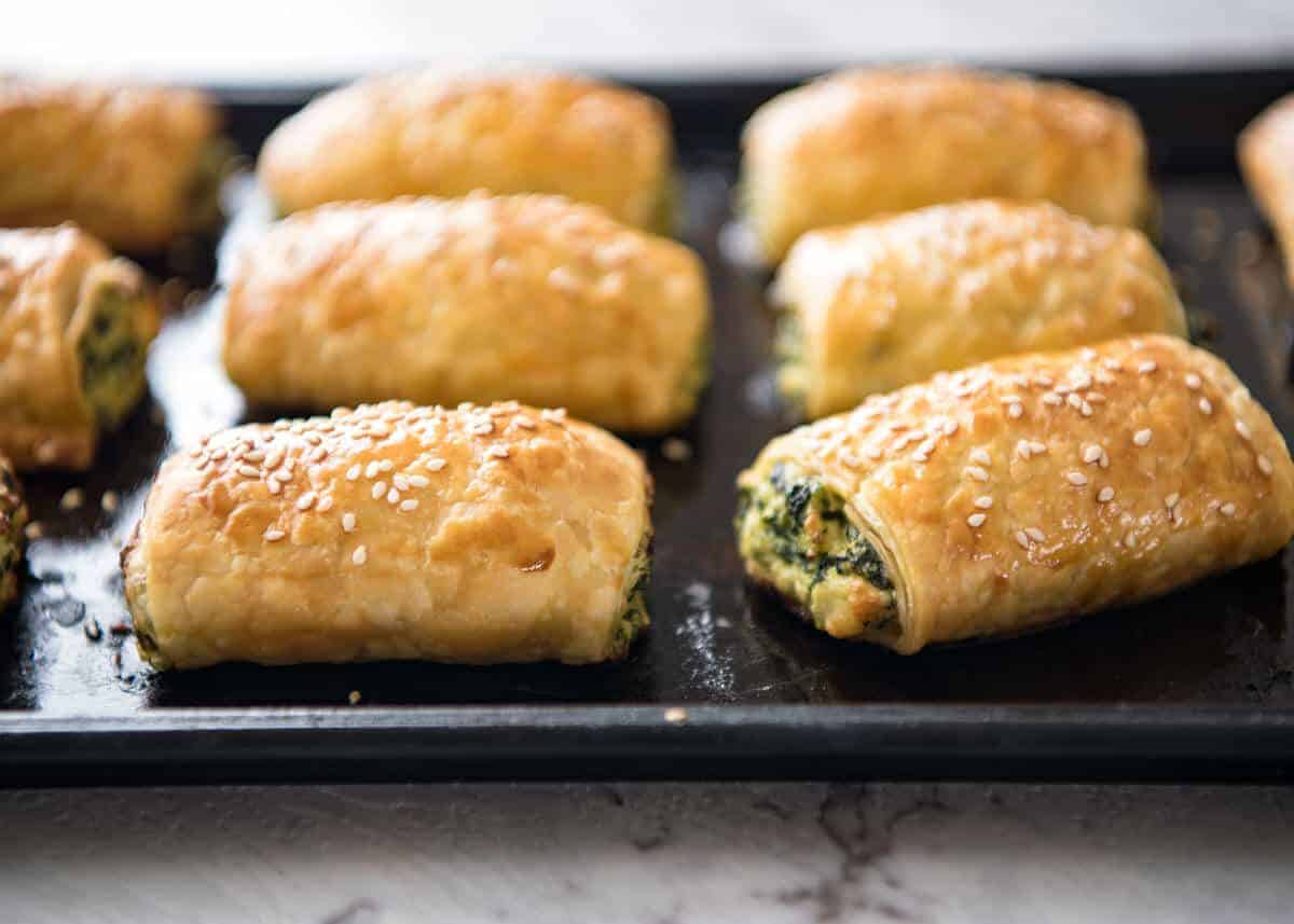 Spinach and Ricotta Rolls - a moist cheesy filling enclosed with buttery flaky puff pastry. Great make ahead for freezing! www.recipetineats.com