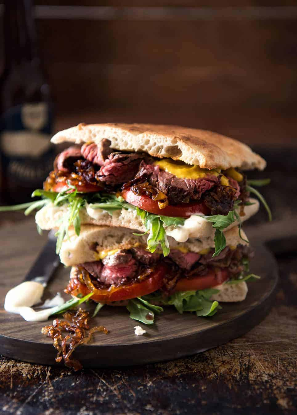 A juicy Steak Sandwich loaded with tender slices of steak, caramelised onion, garlic aioli, lettuce, tomato and mustard. www.recipetineats.com