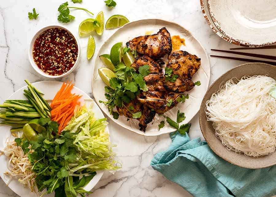 Overhead photo of Vietnamese Noodles with Lemongrass Chicken DIY spread - meal idea for large groups