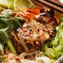 Close up of Vietnamese Noodles with Lemongrass marinated chicken in a bowl, ready to be eaten