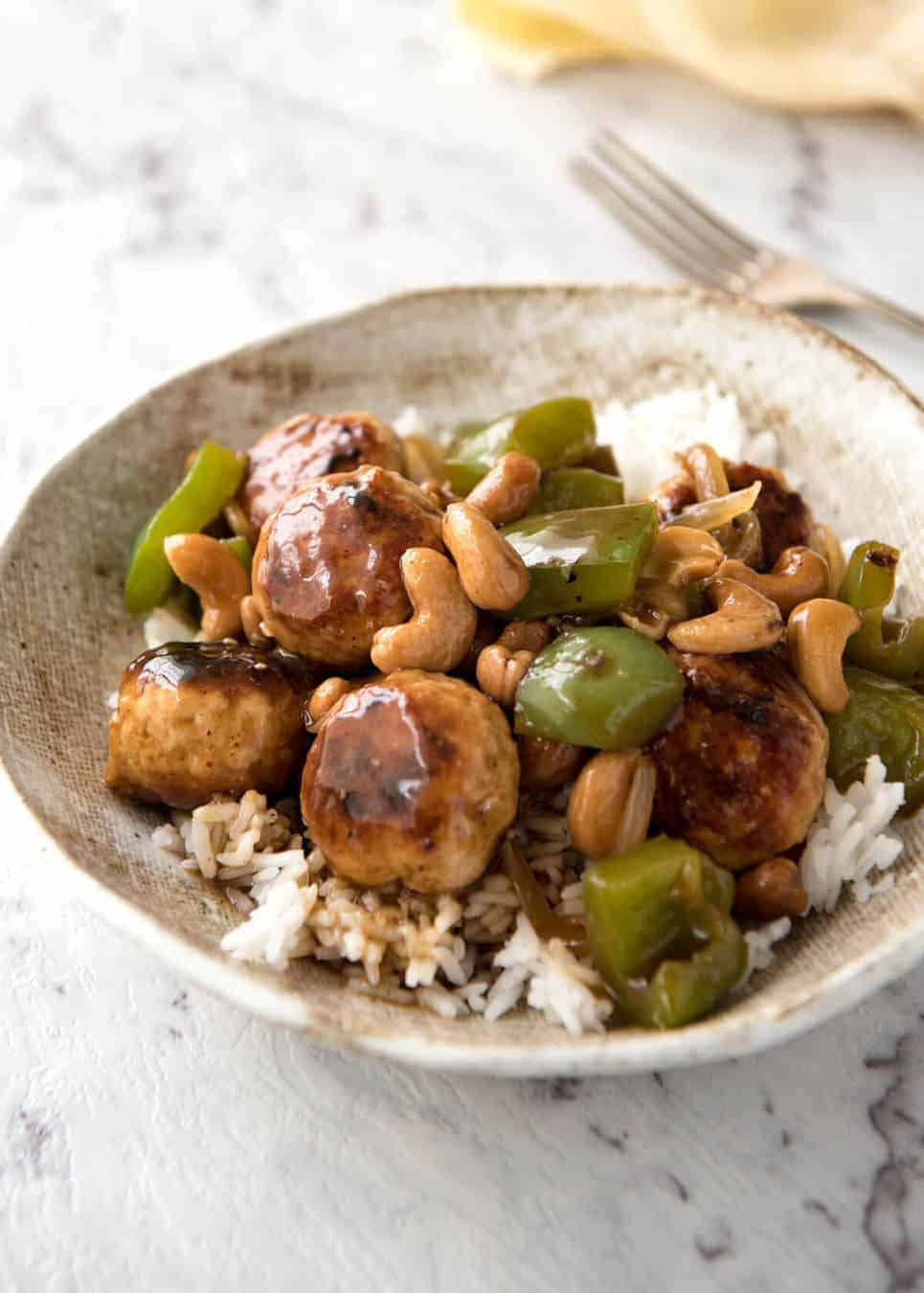 This Chinese Cashew Chicken Meatballs recipe is everything you know and love about Cashew Chicken...made with meatballs! recipetineats.com