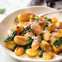 Pan Fried Gnocchi with Pumpkin and Spinach - Golden crispy on the outside, soft on the inside, with a butter sage sauce, roasted pumpkin and spinach. www.recipetineats.com