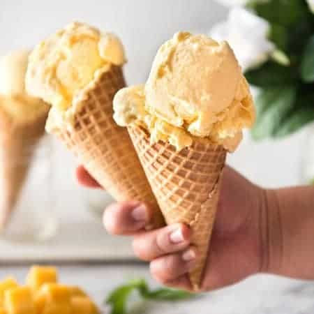 Homemade Mango Ice Cream recipe - Made without an ice cream maker, all you need is mangoes, condensed milk and cream to make this Mango Ice Cream recipe that is truly creamy and scooopable. The real mango flavour is incredible! www.recipetineats.com