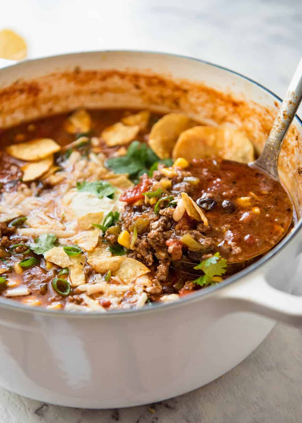 Easy Taco Soup - Made with beef, beans and corn, and either a homemade or store bought taco seasoning. Absolute crowd pleaser, thick and warms the soul. Don't skip the toppings!! www.recipetineats.com